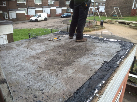 Inspecting old flat roof - W Contractors.